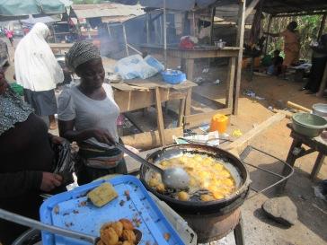 Lady frying Akara